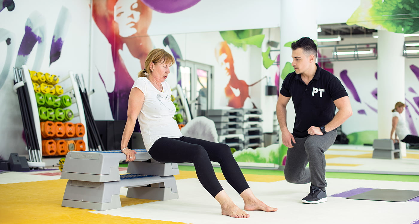 a woman and her trainer at the gym